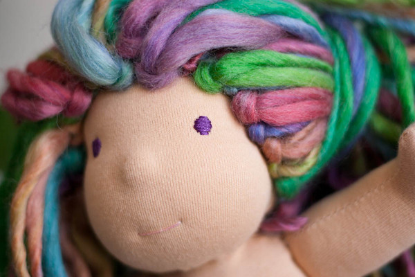 waldorf doll with nose and rainbow hair